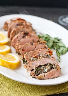 Super flavorful, tender pork loin stuffed with spinach, feta, and sundried tomoatoes #recipe