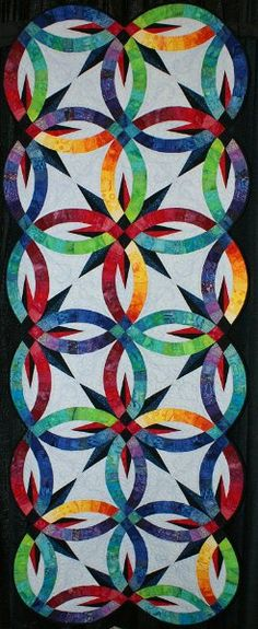 """203.JPG - Honorable Mention Ribbon (Pieced Quilt, small, 2 or more persons)       'Batik Stars' - 29"""" x 76"""" - Quiltmaker: Kimberly Palkowetz; Quilter: Denise Green"""