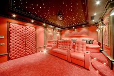 Movie Theater Room-doors look padded for sound insulation.  Love those stars on the ceiling.