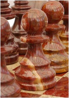 Coral and red marble chess set complete with marble board and case! Beautifully crafted and made to last. M2090. Brought to you by ChessBaron.co.uk #chess #craftsmanship