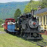 Durbin Rocket, Durbin, WV. The train takes you into the state park and leaves you overnight. You have a whole caboose to yourself in the middle of nowhere. It has a  kitchen & bathroom. Very romantic.