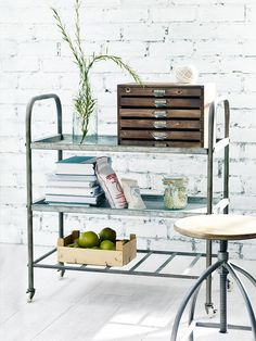 Make an industrial statement with our sturdy vintage style trolley. Made from cold rolled metal with a rusted zinc finish, this large trolley features three strong shelves, two solid and one slatted, with a small rim and a stamped industrial style number on the top shelf. Easy to assembly and complete with four small wheels, this trolley makes useful office, kitchen or living room storage.