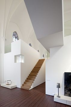 Interior design | decoration | home-converted church, white surfaces, wood staircase + flooring