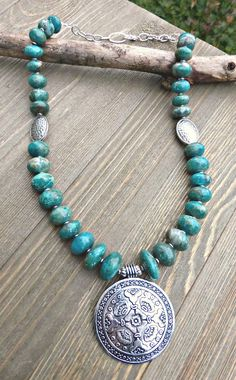 Green turquoise rondelle stone with silver beads and silver pendant necklace.