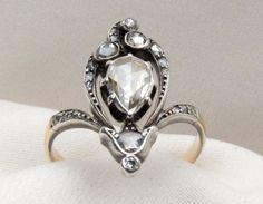 gorgeous diamond ring looks like a fleur de lys