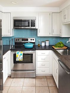 Blue matchstick tiles on the backsplash are the focal point in this small, yet bright, kitchen!