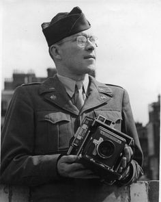 "Veterans Day edition: today's steely-eyed military man with an über-cool camera is LT. SAM VESTAL who was a WWII War Correspondent, photographing the war for ""Stars and Stripes"" in Europe. Not a 'celebrity' -- but über-cool to be sure! We salute you, Lieutenant!"