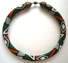 20 around (see pattern) Green, Orange & White