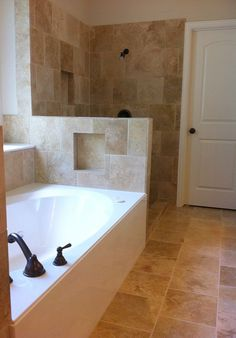 New updated bathroom with travertine shower, tub deck, and flooring along with new paint.