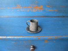The tiniest antique tin cup and plate