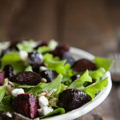 Maple Roasted Beet and Goat Cheese Salad Recipe Salads with beets, walnut oil, maple syrup, salt, lettuce, goat cheese, sunflower seeds, olive oil