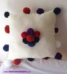 Almohadón de pompones de lana