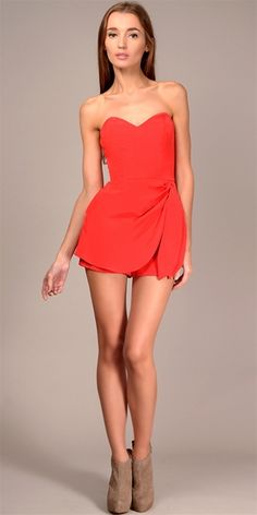 This 4-ply silk romper features a sweetheart bustier romper features a draped wrap front overlay and self sash detail at waist. Side slash pockets. Concealed zipper.100% silkDry clean only