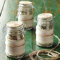 Use these jars a lot, like the fabric fringed base with paper printed label, tied with jute.