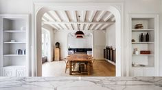 Marble details offset the traditional features of this 19th-century house near Paris, which has been renovated by Spanish studio 05 AM Arquitectura.