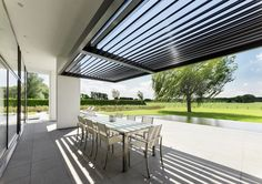 Umbris louvre roof perfect for shading outdoor living spaces | Call Umbris to find out more 01494 722 880