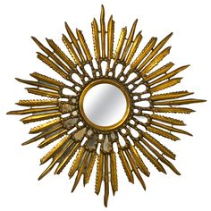 Giltwood Starburst Mirror | From a unique collection of antique and modern sunburst mirrors at http://www.1stdibs.com/furniture/mirrors/sunburst-mirrors/