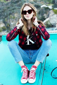 Chiara Ferragni of The Blonde Salad in a black t-shirt, cropped jeans, and red converse