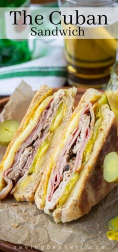 sandwich recipes The Cuban Sandwich (Cubano) ~ a hearty and delicious combination of sweet ham, juicy tender pork, melted Swiss cheese, dill pickles with a nice bite from a slathering of yellow mustard. Sandwich Au Porc, Kubanisches Sandwich, Soup And Sandwich, Cheese And Pickle Sandwich, Cuban Pork Sandwich, Cuban Sliders, Mexican Sandwich, French Sandwich, Snacks