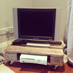 made into smaller version and mounted on wall under a mounted TV to hold cable box, dvd player, etc