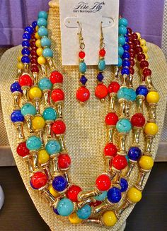 You will wear this spring, summer, and fall! Multi colored beaded necklace and matching earrings.