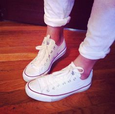White converse and rolled jeans