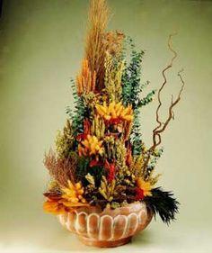 Com assecar:  Flores secas: arreglos y centros.