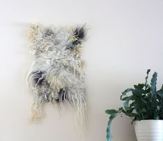 Felt wall hanging handmade from various raw wools