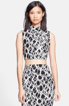 Free shipping and returns on Elizabeth and James 'Aisling' Crop Top at Nordstrom.com. A foiled motif casts a thick tactile web over a street-chic crop top designed with a high mock neck that tastefully balances the midriff-baring hemline.