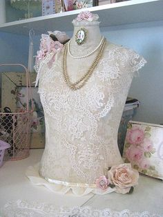 vintage dress form with damask and lace bodice