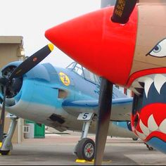 In the WAY close-up, a Curtiss P40. In the backdrop, a Grumman F6F Hellcat.