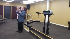 Preaching with baby on hip