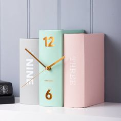 contemporary bookshelf clock by the contemporary home | notonthehighstreet.com