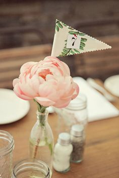 The versatile bottle with single bloom and table number