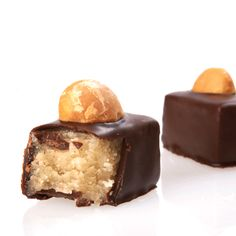 Marzipan: Almond marzipan covered in dark chocolate & topped with a roasted macadamia nut.