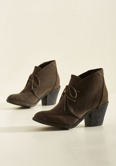 <p>Jump right into a day of wandering with these brown booties from Blowfish! Your first stop? The cafe for a cappuccino, which the angled shafts of your faux-suede kicks kindly oblige. From there, you skip their block heels down to the library for a day spent in intellectual indulgence!</p>
