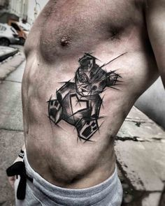 dark teddy bear tattoo on ribs