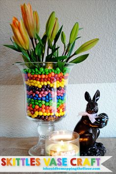 Skittles Vase Craft, perfect for spring! Simple trick to keeping the water and candy separate!