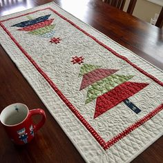 Final finish for I had a couple of blocks left over from a Christmas quilt and in no time I had a new table runner. Xmas Table Runners, Quilted Table Runners Christmas, Christmas Tree On Table, Christmas Runner, Table Runner And Placemats, Table Runner Pattern, Christmas Diy, Purple Christmas, Coastal Christmas