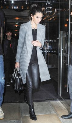 On Jenner: Nasty Gal Off and on Ribbed Crop Top($32); Helmut Lang Faux-Pocket Leather Leggings ($920); Saint Laurent Sac de Jour Small Leather and Snakeskin Tote ($2750); Saint Laurent boots.