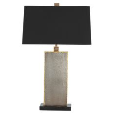 Table Lamps: Graham Lamp (#42683-329). Box design iron table lamp features a reptile-like pattern in a natural iron finish with antique brass edges atop a black marble base. Topped with a black rectangular shaped shade with dark silver sheer lining and matching square shaped finial. 3-way switch.