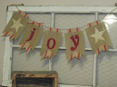 Primitive Christmas *joy* burlap banner... hand painted letters in red with hand crafted rustic stars on natural burlap with gold metallic sparkle