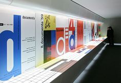 """ART + COM, A touch-sensitive projection surface on the tabletop makes the exploration direct, informative and playful. The content is divided into five themes: """"Curatorial Concept"""", """"Artistic Positions"""", """"Reactions"""", """"Zeitgeist"""" and """"Statistics"""". Interacting with the installation familiarises the visitor with the cultural milestones of the 20th century."""