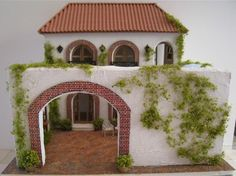 Italian villa dollhouse (image only, no details) - Another courtyard that gives the impression of the outside while not showing anything outside the house.
