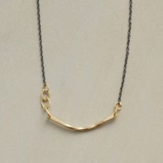 """MIXED METAL SLING NECKLACE--Sarah McGuire suspends a twisted arc of 18kt gold from links of the same precious metal, in contrast to her delicate oxidized sterling silver chain. Hook clasp. Handmade in USA. 16""""L."""