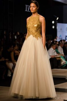 A gold and ivory tulle gown by Indian designer duo Shantanu & Nikhil. Simple but effective. Should you opt for a lehenga or a gown for your reception. Get tips on wedding styling, visit www.bridelan.com - a wedding styling & shopping consultancy in India. #Bridelan