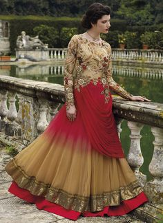 Design, style and pattern would be at the peak of your beauty once you dresses this red and beige net designer gown. This charming dress is displaying some brilliant embroidery done with embroidered a...
