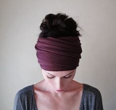 This head scarf sports an ultra soft shade of burgundy. The wide ribbed knit material is a medium weight with a moderate amount of stretch. Incredibly