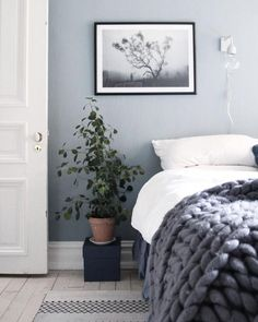 Cosy blue bedroom with chunky knit blanket and white bedsheets, and a framed poster from Printler, the marketplace for photo art. Interior design by Cream and navy. Cosy Bedroom, Blue Bedroom, Bedroom Colors, Bedroom Decor, Design Scandinavian, Scandinavian Bedroom, Greige, Moving House, My New Room