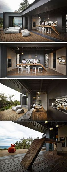 This black kitchen with a wooden countertop opens up to the deck for complete indoor / outdoor living. By using clear glass for the kitchen backsplash, it lets the rocks in the garden appear as a piece of art. When needed, the kitchen can be closed off to the elements with accordion glass doors.